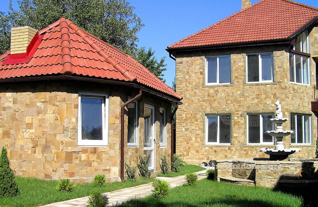 обшивка искуственным камнем фасада