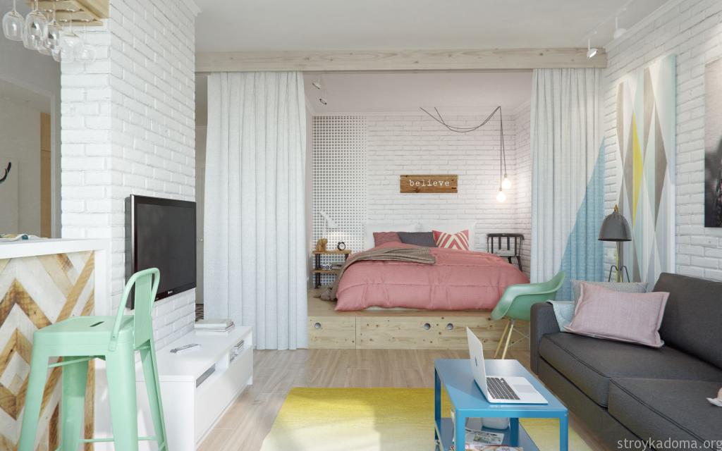 Спальное место однокомнатной квартиры с подиумом