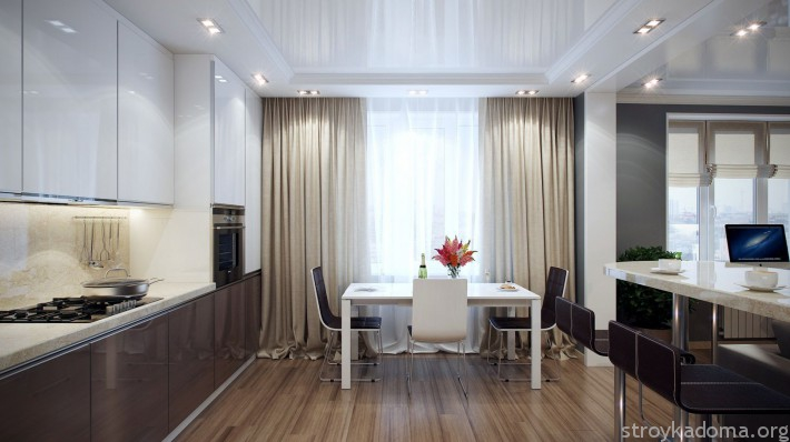 Современная кухня в серо-коричневых тонах выглядит элегантно и нескучно. Ключ к успеху - белоснежная мебель и яркое освещение