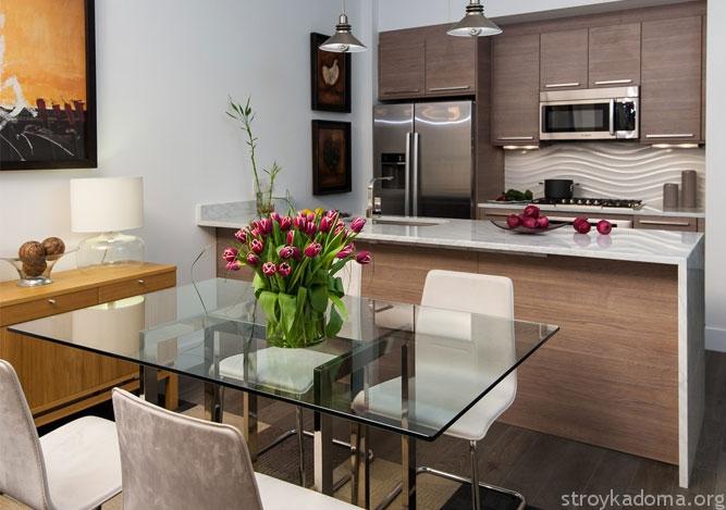 Стол из стекла в интерьере кухни